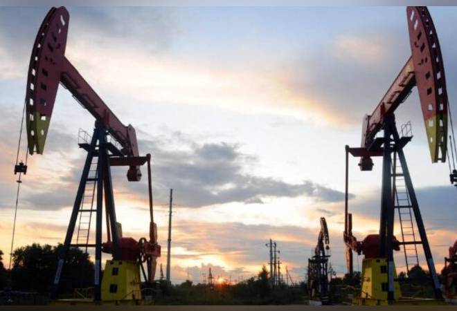 Oil prices slip 2% on inventory rise, slow COVID vaccination