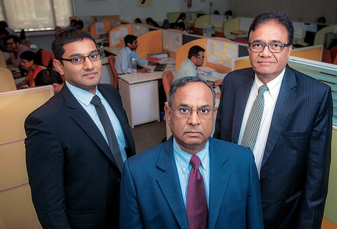 Nrupendra Rao (centre) flanked by his son Aditya Rao (left) and Managing Director PV Rao