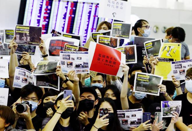 Hong Kong airport resumes operations amid warnings over pro-democracy protests