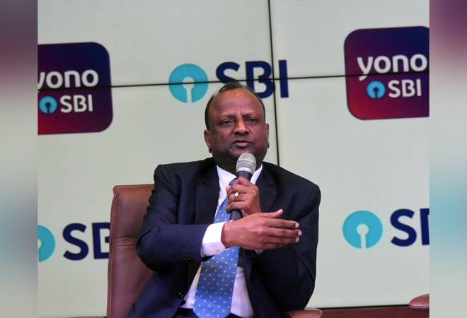 YES Bank crisis: Cash withdrawal curbs will end well before April 3, says SBI chief Rajnish Kumar