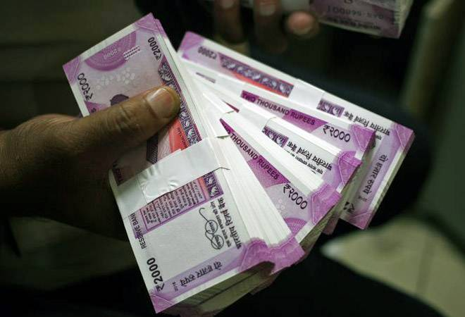 Rs 4 lakh crore old notes in banks may be black