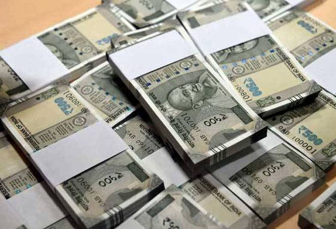 Rupee knocked down 43 points to end at life-time low of 69.05 against dollar