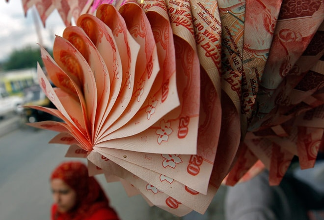 Rupee closes higher on dollar selling