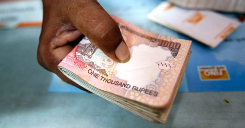 Rupee falls 27 paise to 61.50 on importer demand