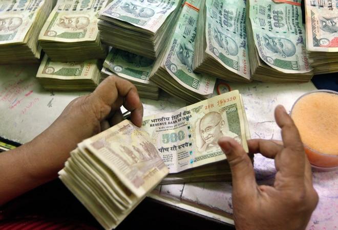 Rupee closes lower against dollar