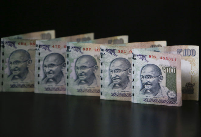 Rupee closes 19 paise lower at 63.66