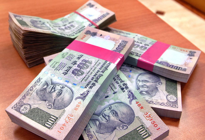 Rupee up 6 paise against US dollar, at 62.44