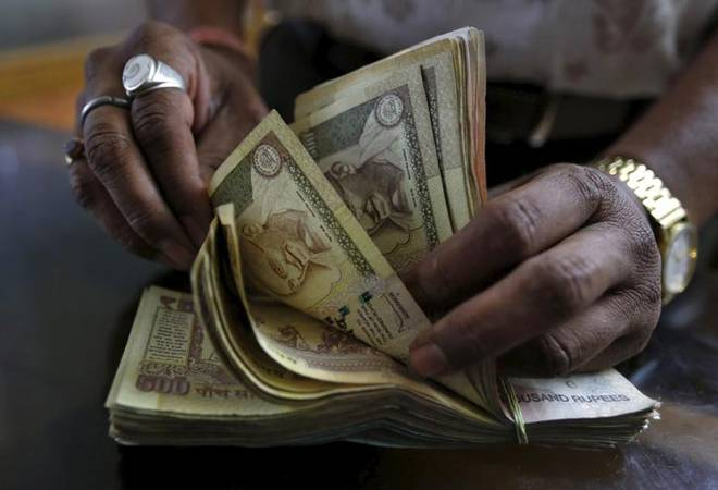 Rupee plunges to 28-mth low, closes at 67.95