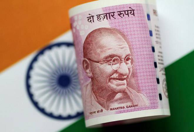 Rupee closes higher at 69.68 against dollar
