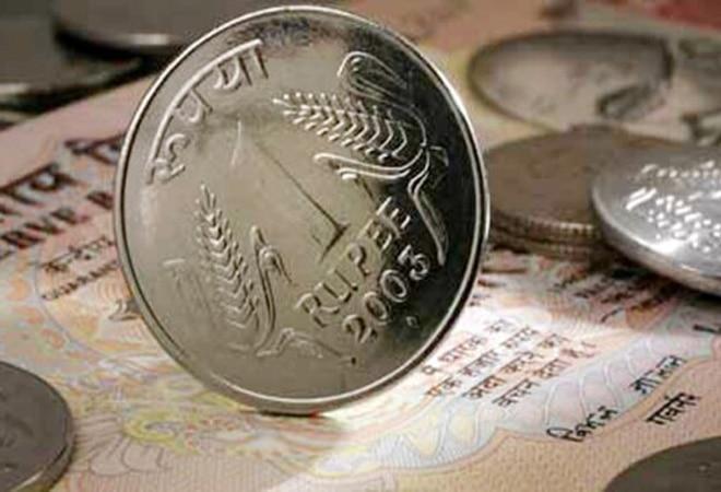 Rupee appreciates 4% against dollar in FY21