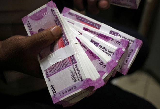 Rupee rises 9 paise to 70.25 against the dollar