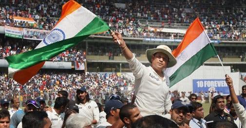 Sachin Tendulkar is given a farewell lap by his team mates after he bid a tearful adieu to international cricket at Wankhede Stadium in Mumbai