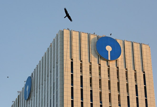 SBI writes off bad loans worth Rs 1.63 lakh crore in 5 years; Alok Ind, Bhushan Steel top defaulters