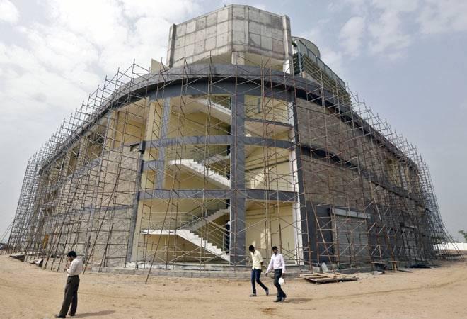A cooling system plant under construction inside Gujarat International Finance Tec-City (GIFT) at Gandhinagar, in Gujarat.