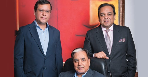 Subhash Chandra (seated) with sons Amit (left) and Punit