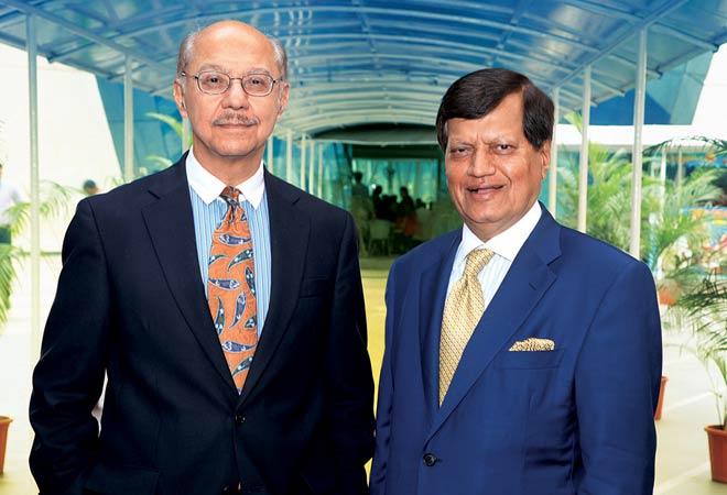 Sunil Wadhwani (L) and Ashok Trivedi, Co-founders, iGate