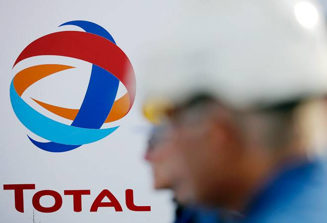 Total in talks to buy stake in Adani's LNG, city gas projects