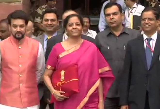 No briefcase! Nirmala Sitharaman carries budget documents in red cloth with national emblem, ribbon