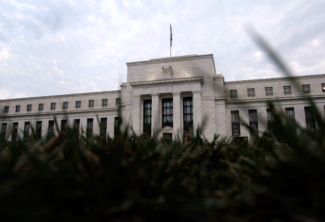 Fed pressed ahead with rate hike plan in Dec policy meet