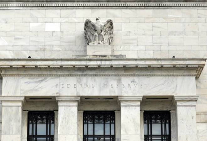 US Fed cuts interest rates, signals it is on hold