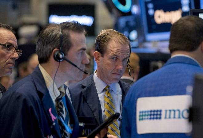 US markets end slightly higher after Monday's steep declines