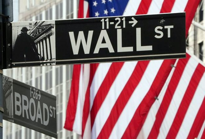 Wall Street's main indexes hit record highs on Monday, as investors made risky bets on hopes that a fiscal relief package would lead to a speedy economic recovery