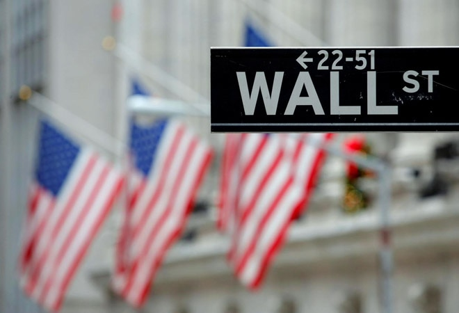 Wall Street rises ahead of Amazon, Alphabet earnings; pandemic relief package