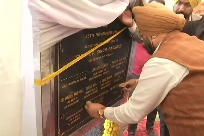 To protest against the Badals' name featuring on the stone, Punjab minister Sukhjinder Singh Randhawa pasted black tape