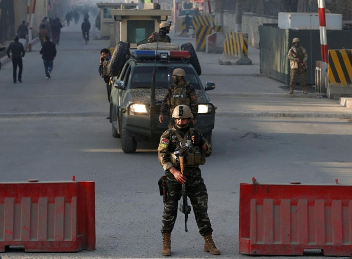 Afghan security forces at a check point close to the compound of the national intelligence agency in Kabul, which was attacked on December 25.