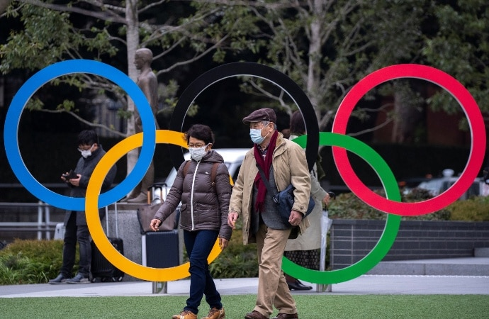 People in masks outside the Japan Olympic Museum in Tokyo. Photo: Reuters