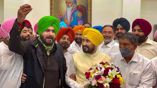 Channi and Sidhu at CM ceremony.Photo: DailyO