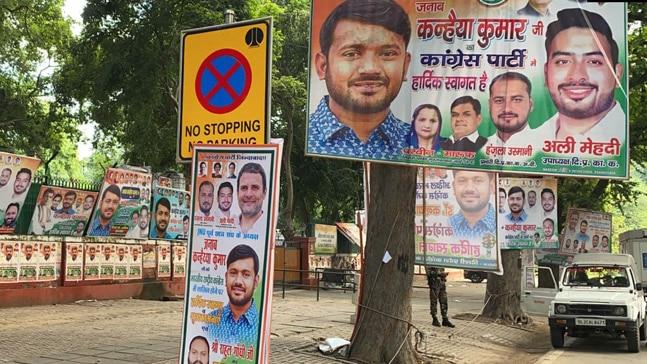 Boards announcing Kanhaiya Kumanr and Jignesh Mevani joinging Congress. Photo:ANI