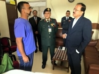 New Delhi  Union MoS Defence Subhash Bhamre meets IAF Wing Commander Abhinandan Varthaman at an armed forces medical facility in New Delhi on March 3  2019 Abhinandan  who returned home on Friday  is undergoing a thorough medical check up at the hos