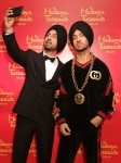 New Delhi  Actor Diljit Dosanjh poses with his wax statue that was unveiled at Madame Tussauds museum  in New Delhi  on March 28  2019  Photo  IANS