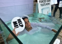 Activist from  PETA proests against the forced swim test