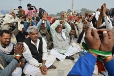 Farmers during a protest against Government at DND flyover