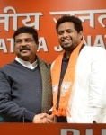 Saumitra Khan and Dharmendra Pradhan together on the stage