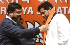 Dharmendra Pradhan welcoming Saumitra Khan to the party