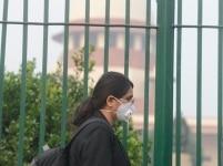 Lawyer wear anti pollution mask amid heavy smog