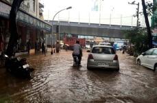 Mumbai  Commuters drive through a water logged street as rain lashes Mumbai on June 7  2018  Photo  IANS