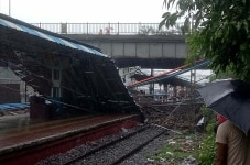 Mumbai  The site where a section of a foot overbridge caved in over the Western Railway  WR  tracks following incessant rain  leaving five persons injured  and creating a scare among the commuters in Mumbai  on July 3  2018  Photo  Sandeep Mahankal