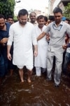Patna  RJD leader Tejashwi Yadav takes stock of the situation of water logging followed by heavy rains  during his visit to Ashoknagar area of Patna on Aug 1  2018  Photo  IANS
