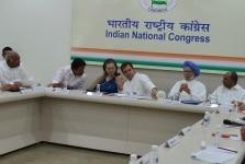 Rahul Gandhi with Sonia Gandhi and Manmohan Singh at CWC Meeting