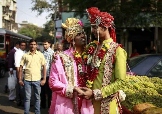 Gay activists dressed as newly wed grooms attend a gay pride parade, which is promoting gay, lesbian, bisexual and transgender rights, in Mumbai