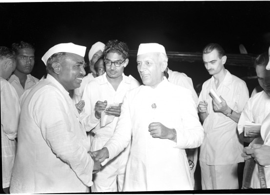 Ph. Studio/May, 57, A22a(I)/A22(u) The Prime Minister Shri Jawaharlal Nehru being greeted on his return from Ceylon in New Delhi at Palam Airport by Shri jagjivan Ram Union Minster for Railways on May 20, 1957.