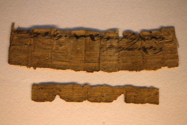 """Fragments of a papyrus bearing the word """"Jerusalem"""", which the Israel Antiquities Authority said on Wednesday is written in ancient Hebrew and is the earliest reference to Jerusalem in an extra-biblical document dating back to the time of the First Temple period or 7th century BCE, is seen on display after an Israel Antiquities Authority news conference in Jerusalem October 26, 2016. REUTERS/Ammar Awad"""