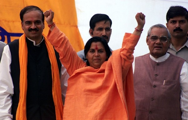 Bharatiya Janata Party leader and former Madhya Pradesh Chief Minister, Uma Bharti, attend a public rally in Amritsar. Bharatiya Janata Party (BJP) leader and former Madhya Pradesh Chief Minister, Uma Bharti (C), along with former Indian Prime Minister Atal Bihari Vajpayee (R), attend a public rally near Jalianwala Bagh in Amritsar September 25, 2004. REUTERS/Munish Sharma - RP5DRIAGBAAA