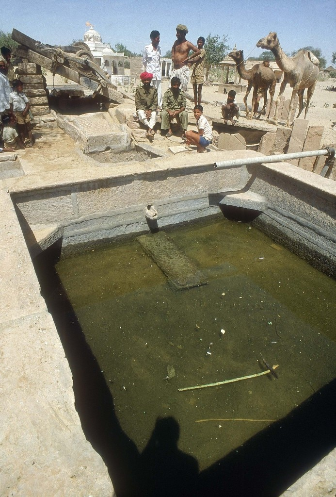Villagers looking at water tank waiting for Water Crisis to be over in Rajasthan ( Rural Areas, News Profile )