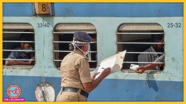 श्रमिक स्पेशल ट्रेन में सवार मजदूरों की जानकारी दर्ज करती आरपीएफ की एक महिला कर्मचारी. (Photo: PTI)
