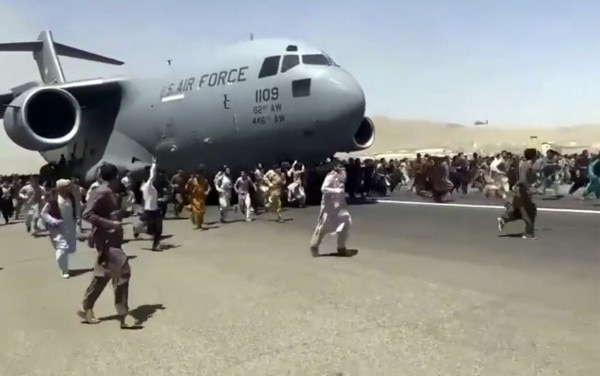Thousands Of Afghans Have Rushed Onto The Tarmac